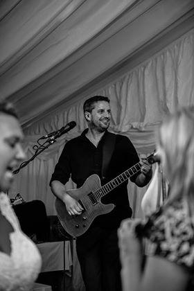Nick Playing With The Band At A Wedding