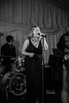 Jess Singing With The Band At A Wedding